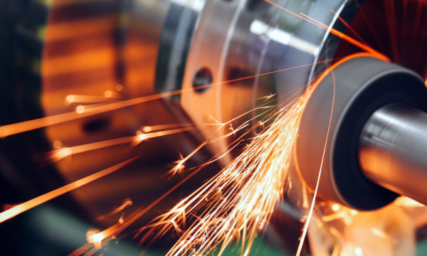 Sparks fly during the machine finishing process.