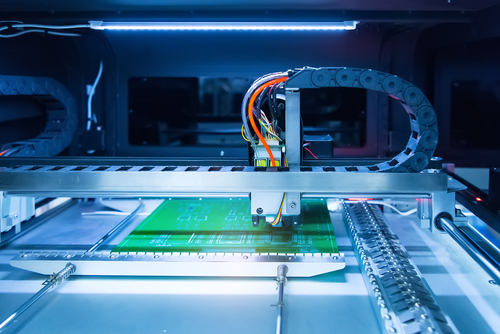 Automated linear system for soldering iron tips and assembling PCB boards.