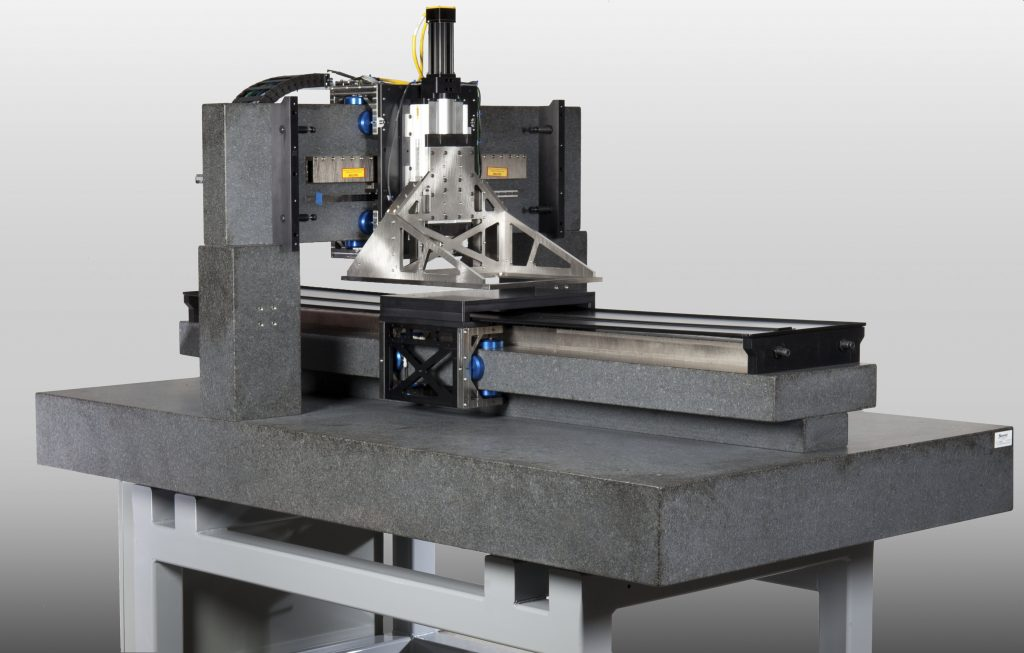 A machining tool equipped with a linear slide from New Way Air Bearings. The slide allows the machining tool to translate friction-free.