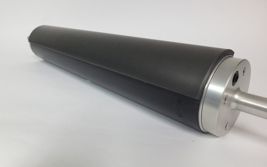 New Way Air Turn featuring a porous media wrap which uses air to move a product without contact or moving parts.
