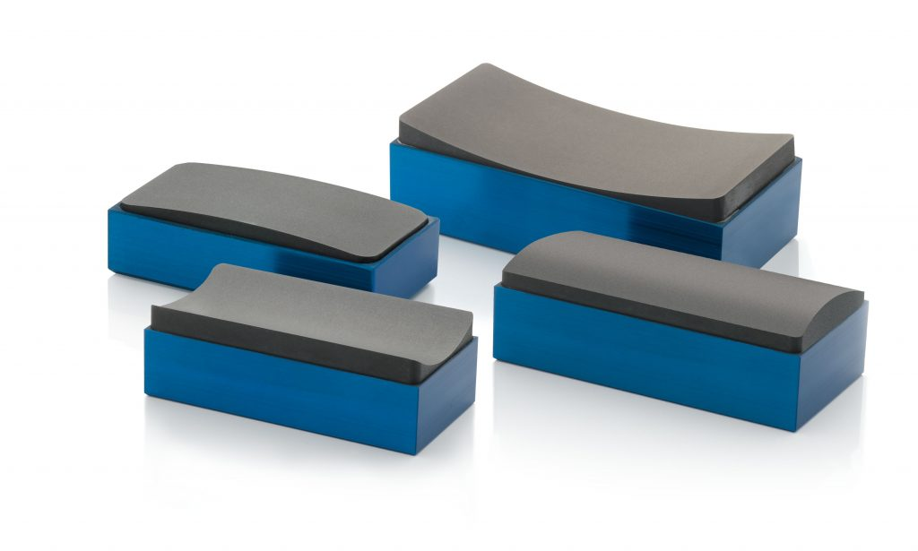 Collection of four New Way radial air bearings shown in both concave and convex profiles.