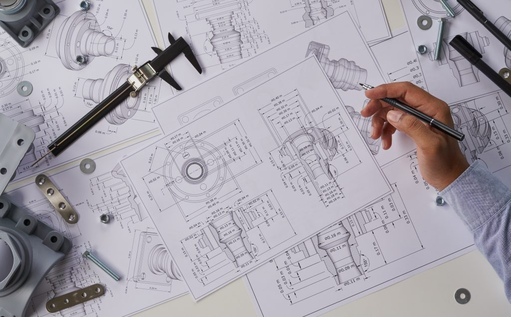 Engineer examining technical drawings.