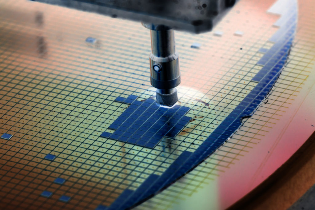 Silicon wafers being attached to a die.