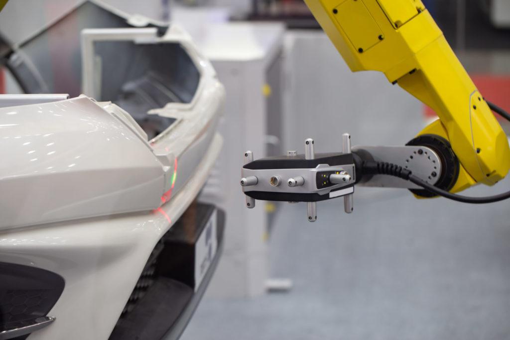 Automated robotic CMM Coordinate Measuring Machine scanning car bumper automotive industry.