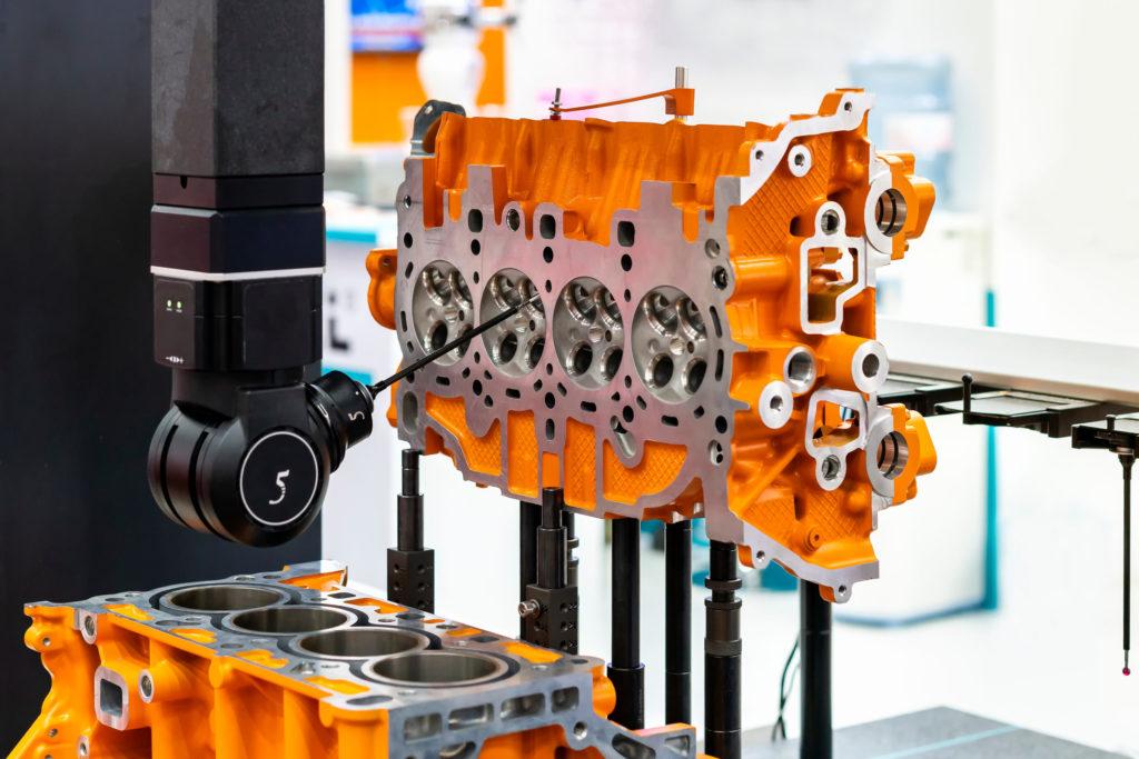 Coordinate measuring machine inspects an engine block.
